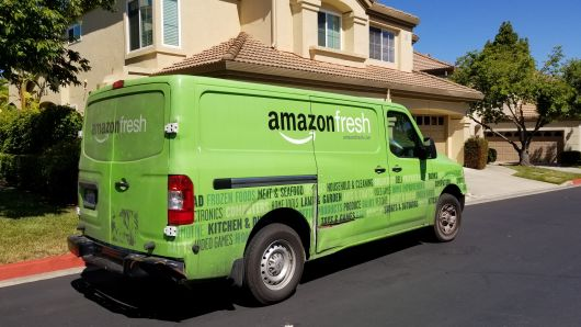 Amazon Fresh grocery delivery truck from the Amazon Prime service parked on a suburban street in San Ramon, California, July 5, 2018.