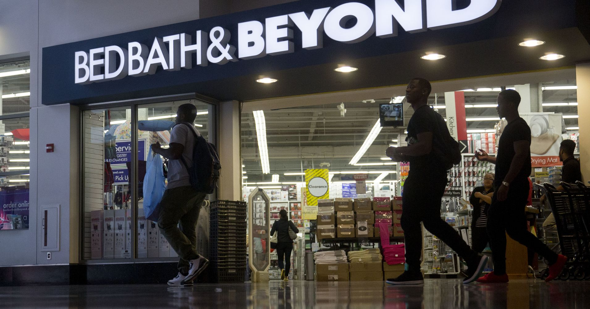 Shoppers walk past a Bed Bath & Beyond store in Washington, D.C.