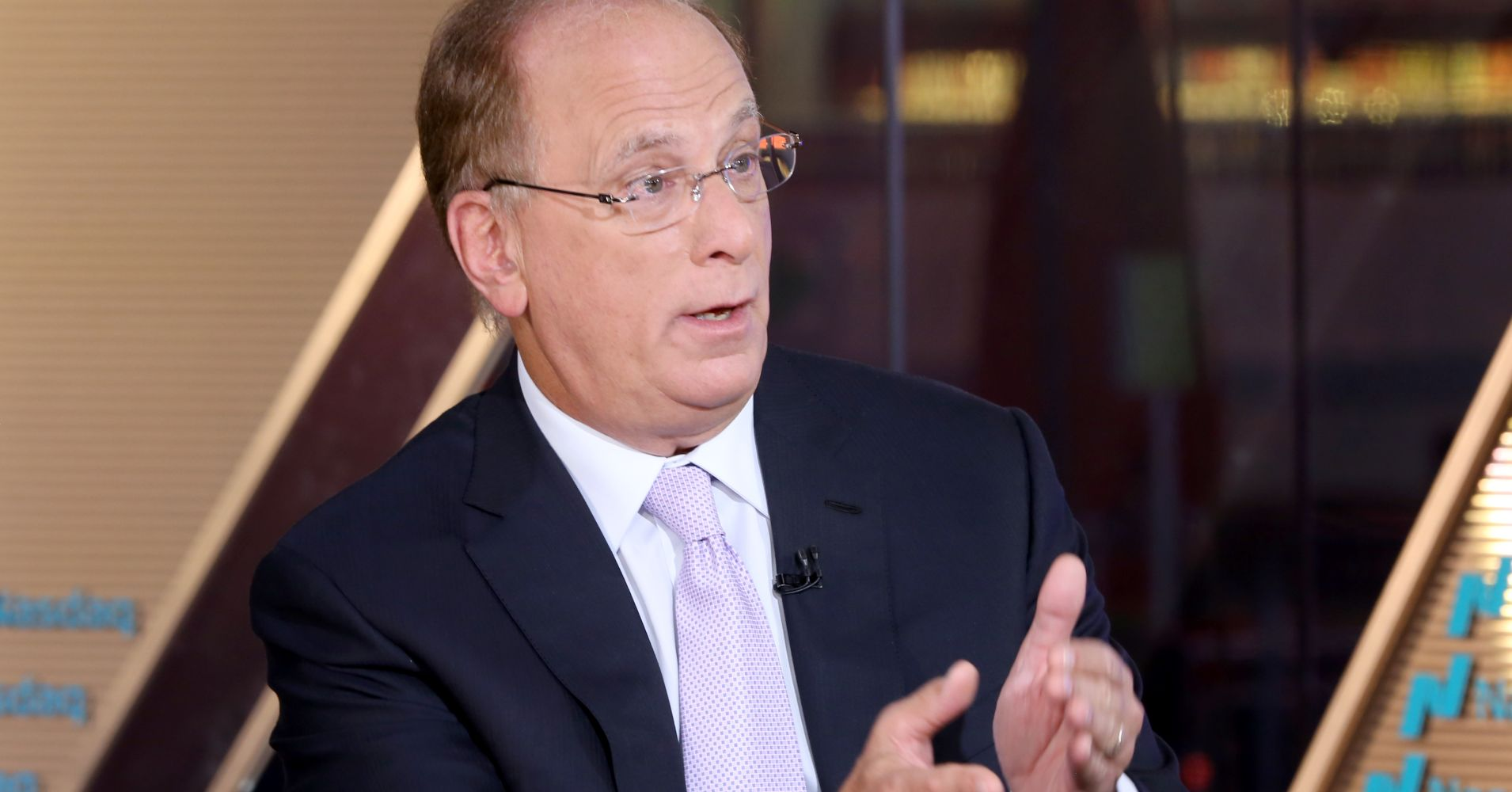 BlackRock's Larry Fink says there are no signs of global recession in the next 12 months