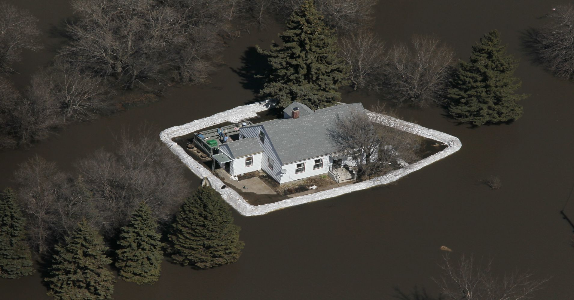 A house is surrounded by floodwater from the Red River on April 11, 2011 near Fargo, North Dakota. Although the Red River crested in Fargo on Saturday at 38.75 feet, the fourth-highest flood on record, areas north of the city are still experiencing near-record flooding.