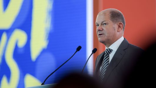 German Finance Minister and Vice-Chancellor Olaf Scholz addresses  the second day of French employers