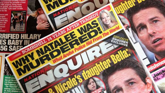 In this photo illustration, celebrity gossip dominates the cover of a National Enquirer magazine on April 11, 2019 in Chicago, Illinois.