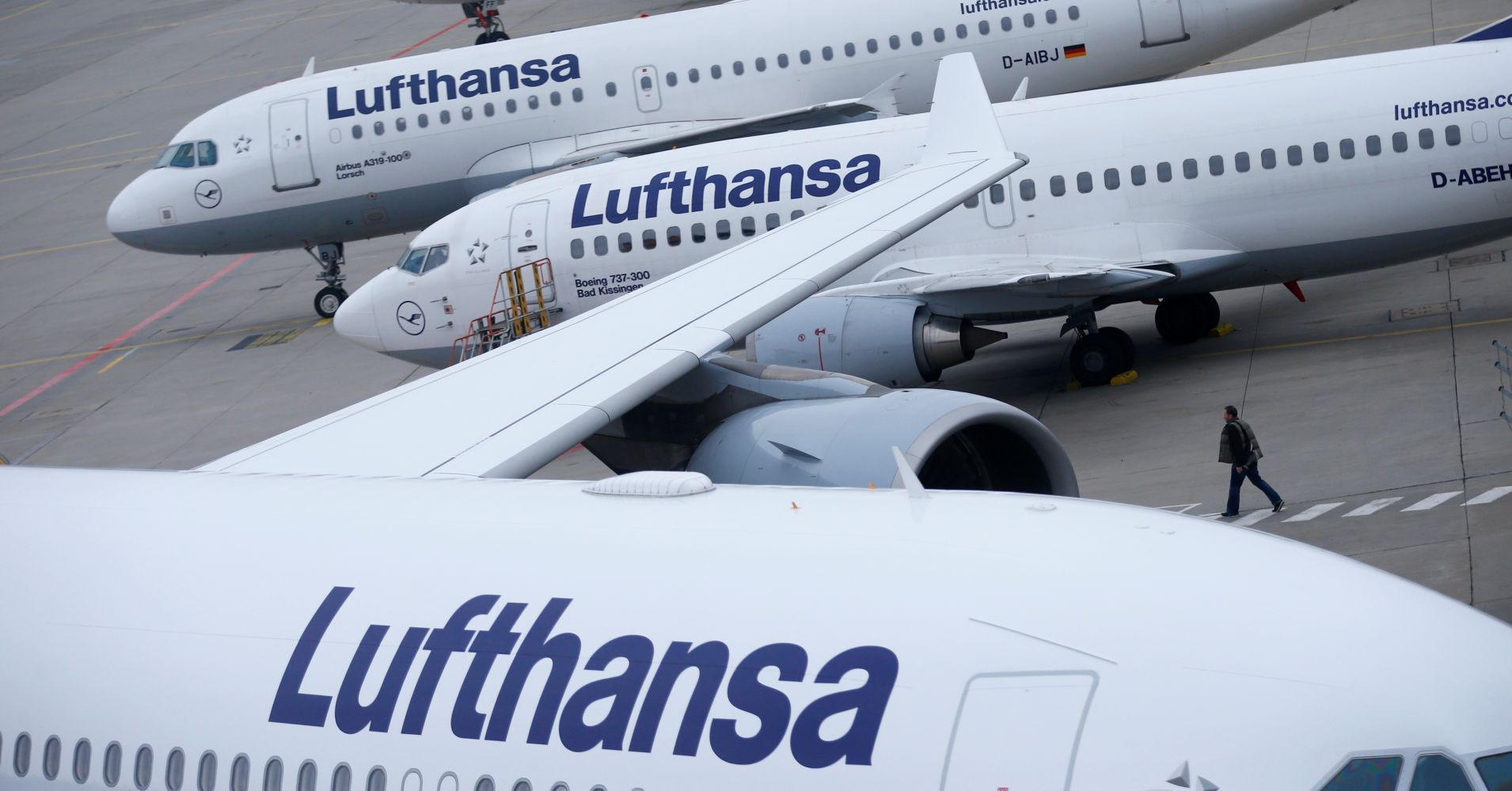 Lufthansa airplanes are parked on the tarmac at Frankfurt airport, Germany.