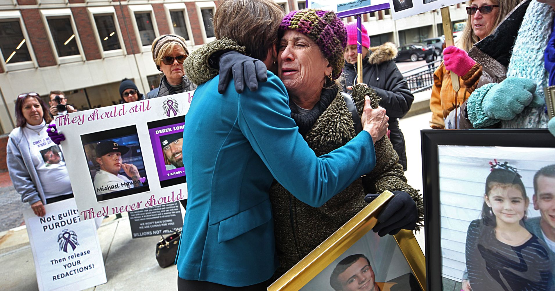 Attorney General Maura Healey hugs Paula Haddad, whose son Jordan died from opioids at the age of 26, as Healey entered the courthouse at Suffolk Superior Court in Boston for a status update on the Attorney General's suit against Purdue Pharma on Jan. 25, 2019.