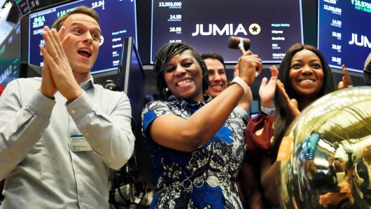 Jumia co-CEO Sacha Poignonnec, left, applauds as Jumia Nigeria CEO Juliet Anammah, center, rings a ceremonial bell when the company