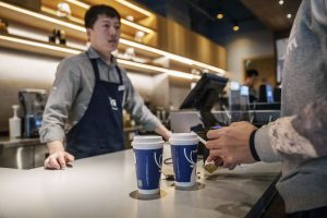 China-based Luckin Coffee CFO on IPO day on differences from Starbucks