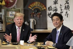 Trump concludes Japan visit as trade official plays down August deal