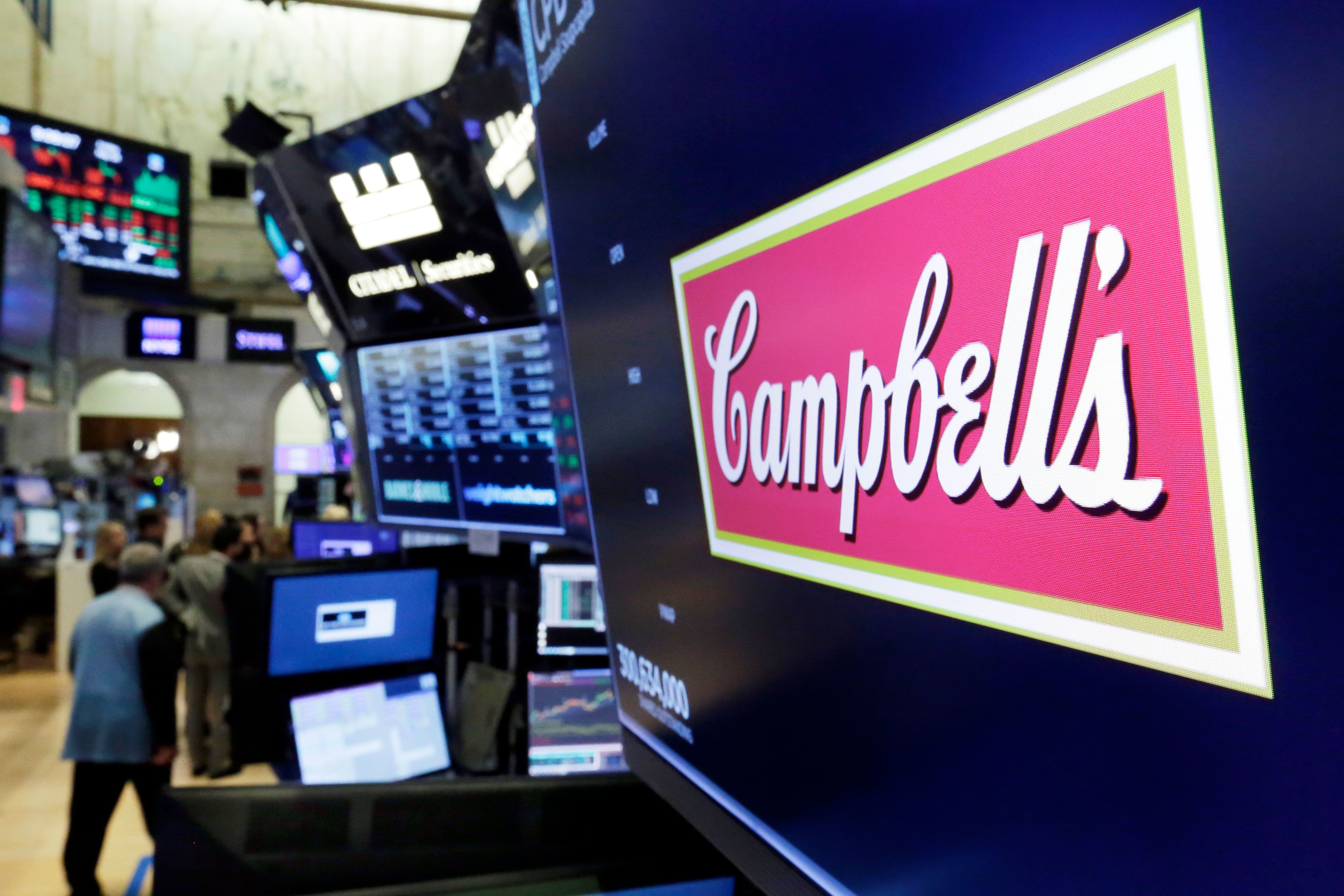 Campbell raises profit forecast on snack boost, shares up 10%