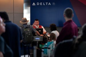 Delta flights delayed after technical issue halts check-ins, boarding