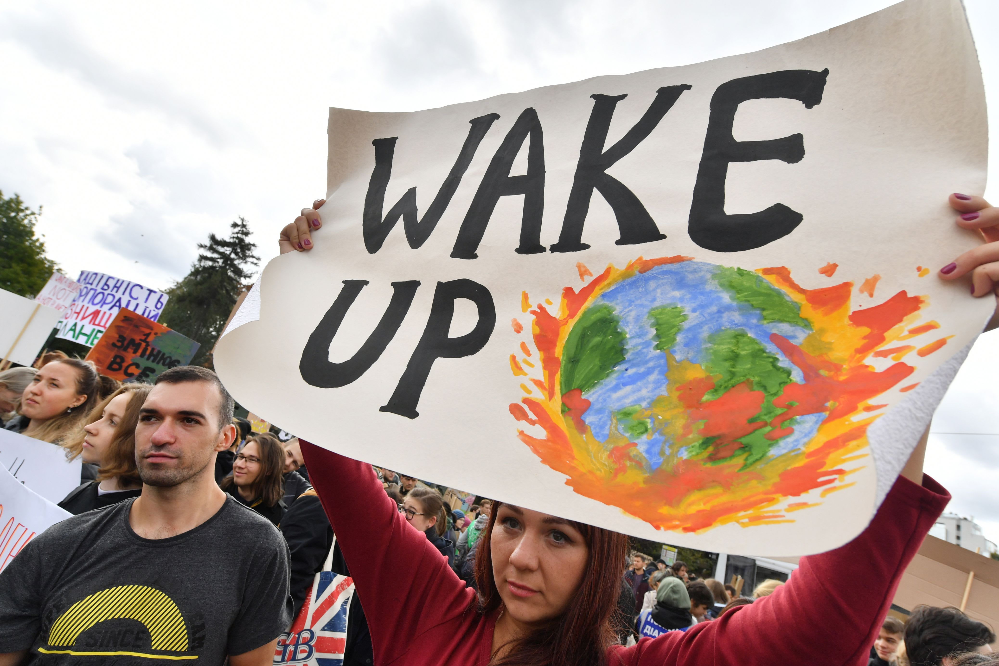 Millions of protesters worldwide come together to demand action on climate change
