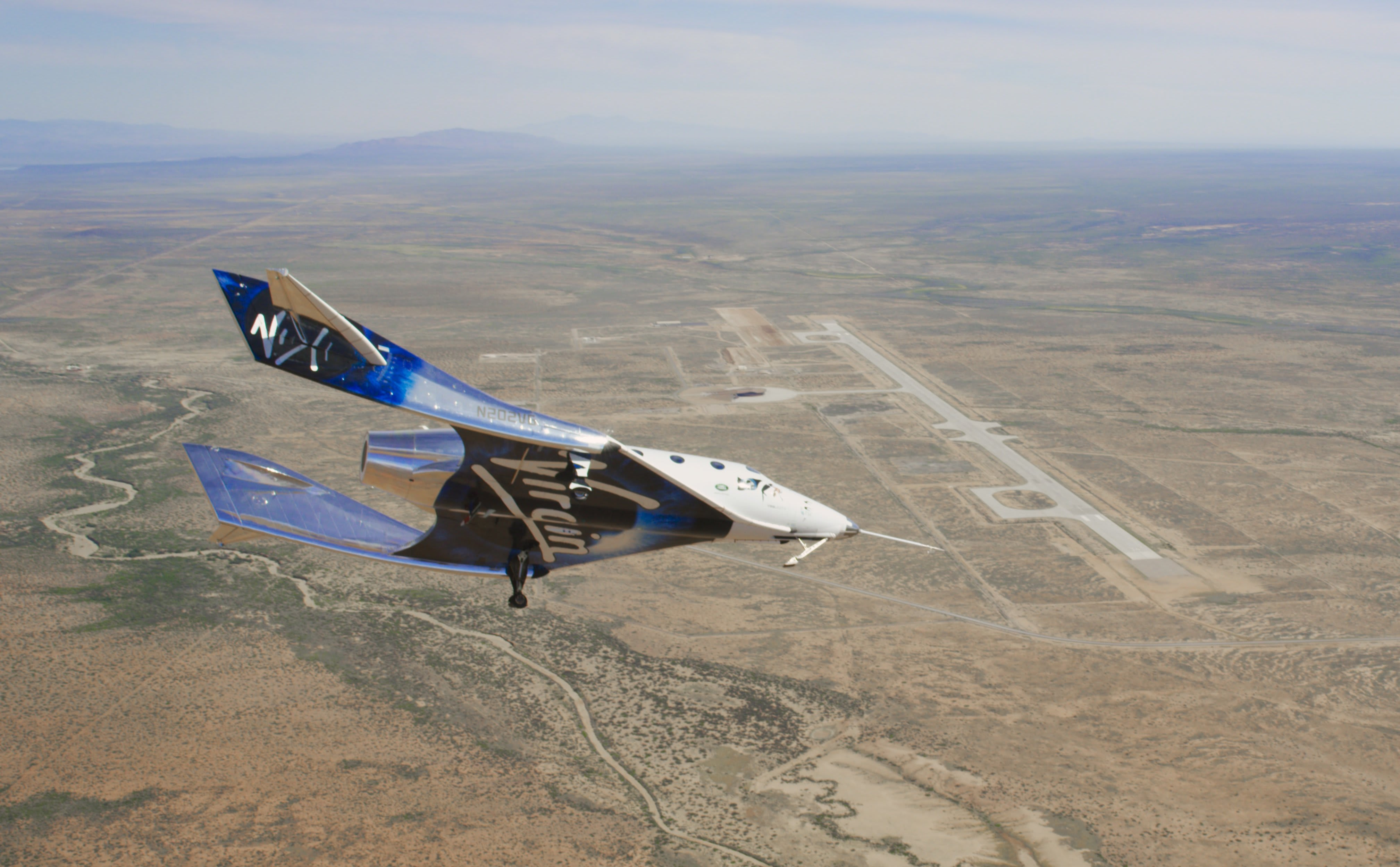 Virgin Galactic completes second glide test, rocket-powered flights next