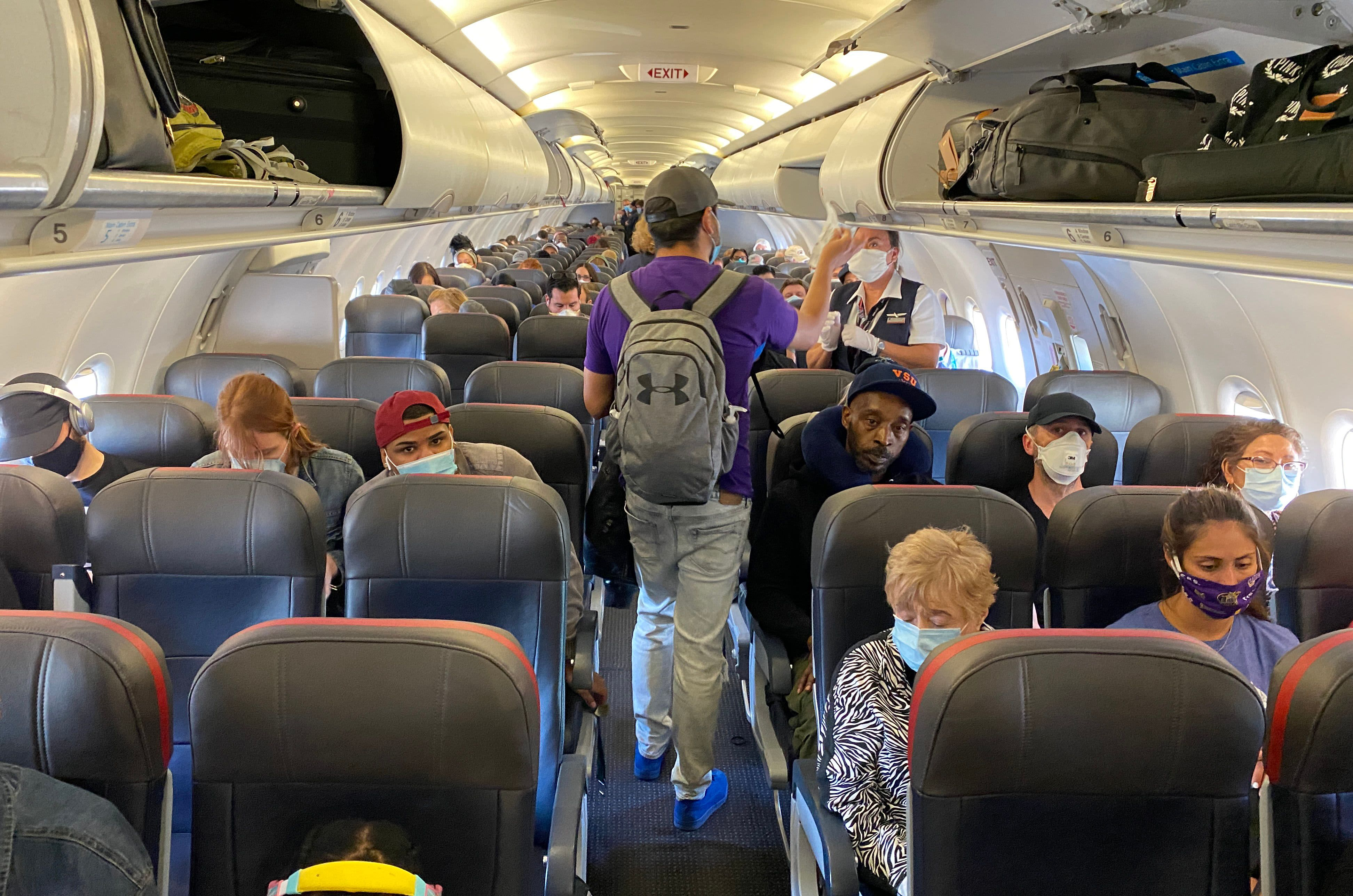 Biden signs order requiring travelers wear masks on planes and at airports as pandemic rages