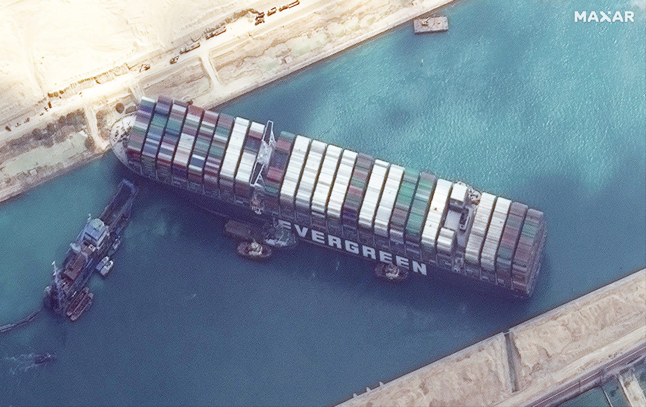 Satellite imagery shows work underway to free ship Ever Given in the Suez Canal
