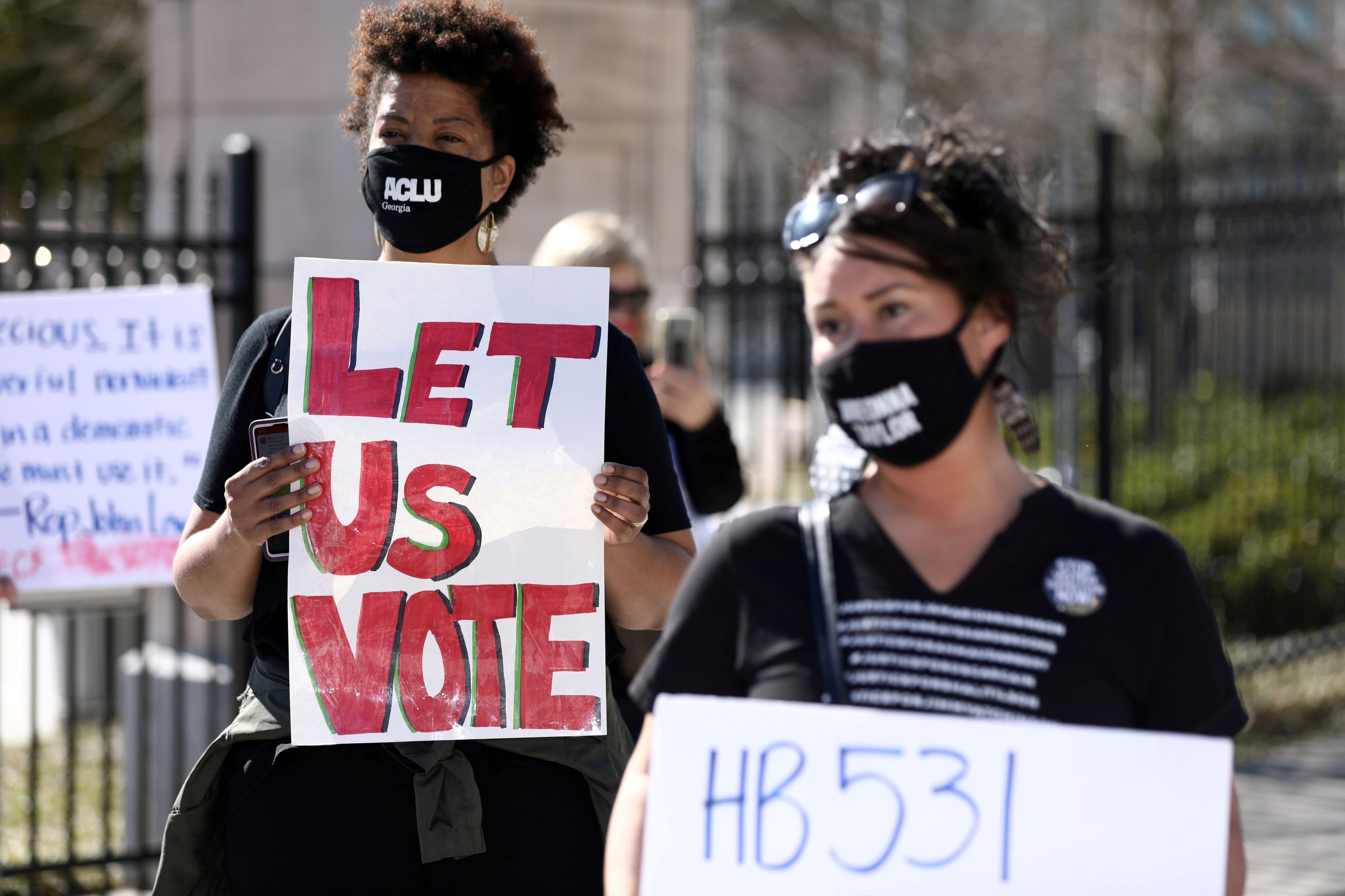 U.S. companies face boycott threats, mounting pressure to take sides in America's battle over voting rights
