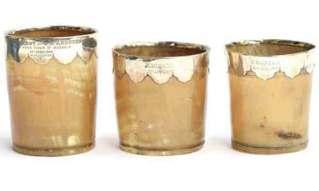 Three copper-colored vessels made from horn
