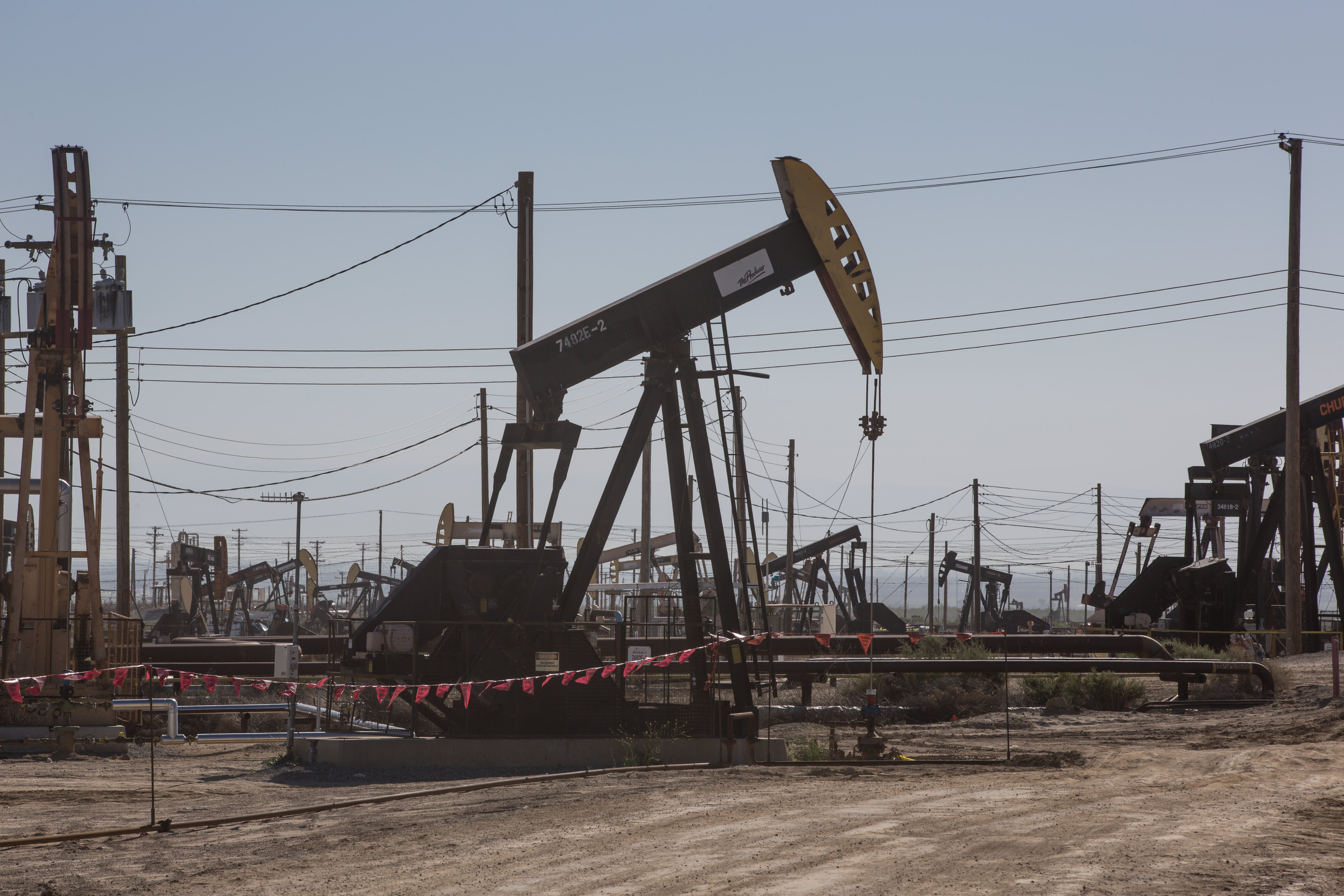 U.S. oil drops 6% to below $70 as OPEC prepares to boost production, Covid concerns weigh