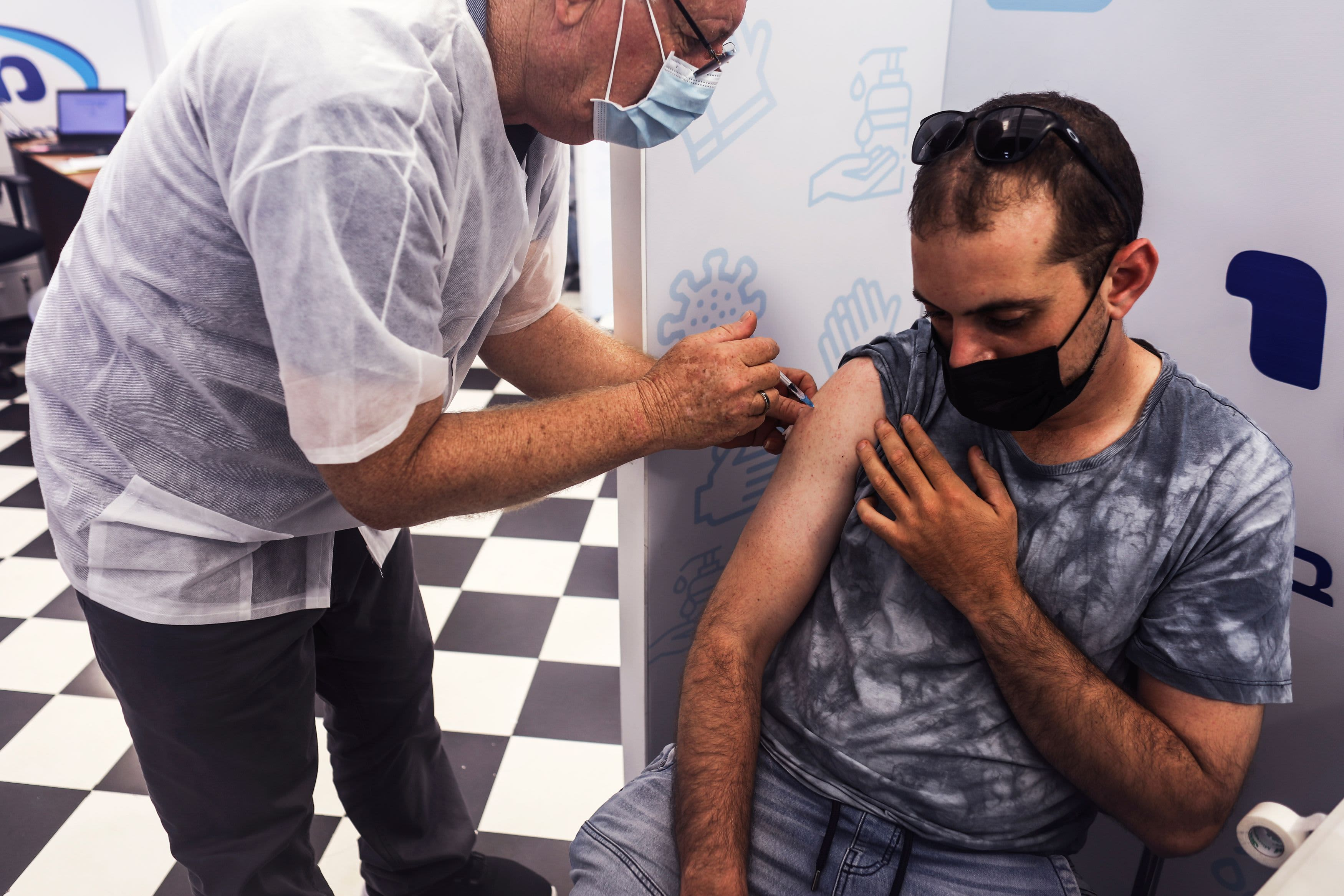 Israel doubles down on booster shots as daily Covid cases set new record